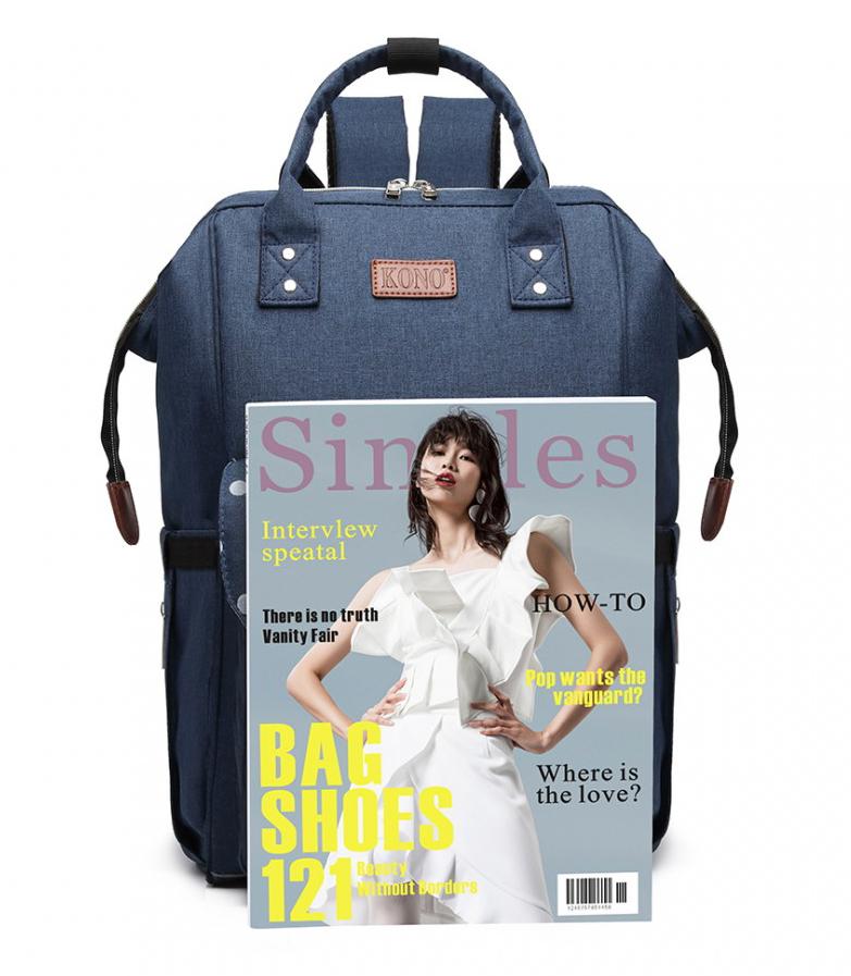 KONO Modrý mateřský batoh s puntíky a USB vhodný i na kočárek
